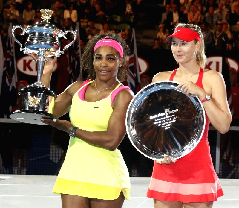 Serena Williams (L) of the United States and Sharapova of Russia pose with their trophies after the women's singles final match at the Australian Open tennis ...