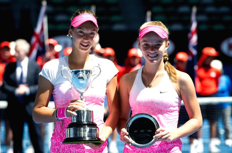 Tereza Mihalikova (L) of Slovakia and Katie Swan of Britain show their trophies after the Junior Girls' Singles final match at the 2015 Australian Open tennis ...