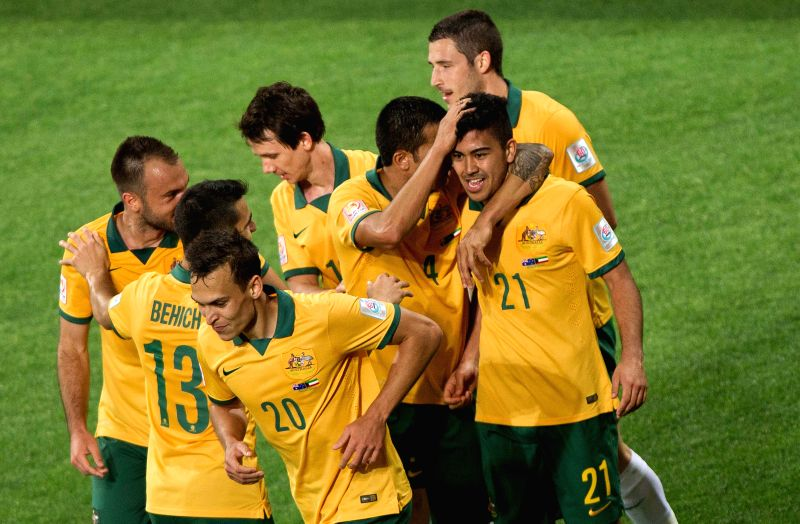 Australian Socceroos players celebrate after scoring during the opening match of AFC Asian Cup between Australia and Kuwait at Melbourne Rectangular Stadium in ...