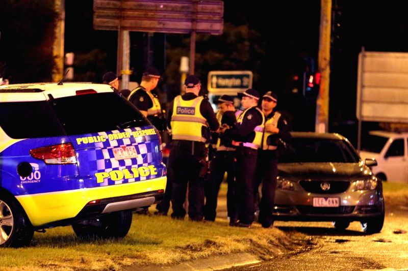 MELBOURNE, June 5, 2017 - Photo taken on June 5, 2017 shows Police and emergency services close to the scene of a hostage situation in Melbourne, Australia. Two people are dead, and three police ...