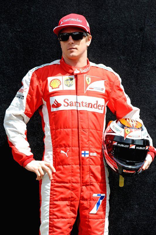 Ferrari Formula One driver Kimi Raikkonen of Finland poses for the season-opening driver portrait session ahead of Australian Formula One Grand Prix at Albert ...