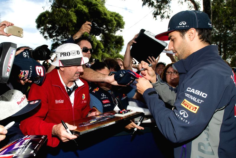 Infiniti Red Bull Racing Formula One driver Daniel Ricciardo of Australia signs autographs for his supporters ahead of Australian Formula One Grand Prix at ...