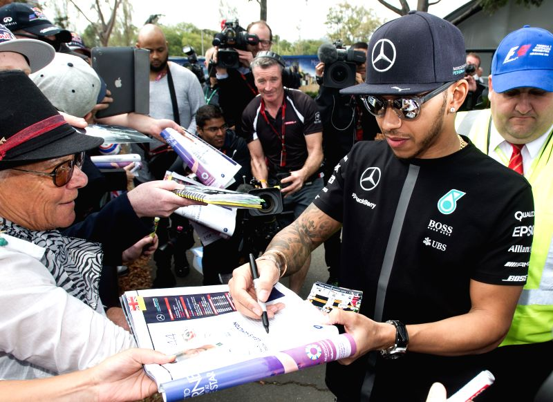 Mercedes AMG Petronas Formula One driver Lewis Hamilton of Great Britain signs autographs for his supporters ahead of Australian Formula One Grand Prix at Albert ...