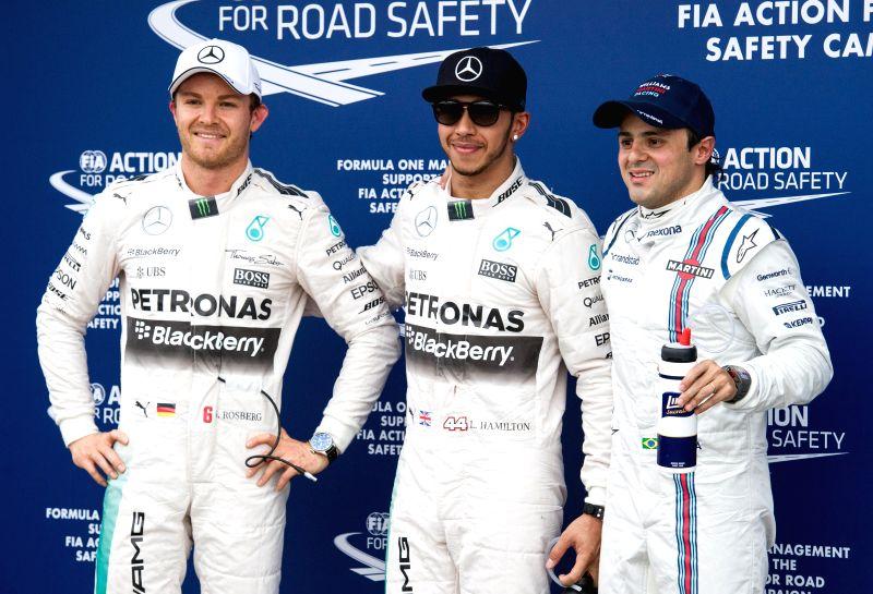 Mercedes AMG Petronas Formula One driver Lewis Hamilton (C) of Britain and teammate Nico Rosberg (L) of Germany, Williams Martini Racing Formula One driver ...