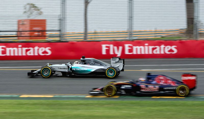 Mercedes AMG Petronas Formula One driver Lewis Hamilton (L) of Britain races during the qualifying session of Australian Formula One Grand Prix at Albert Park in ...
