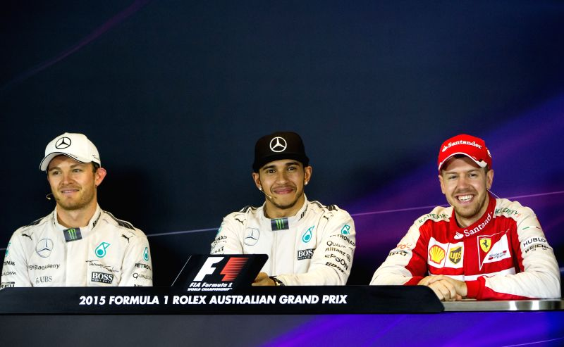 Mercedes AMG Petronas Formula One driver Lewis Hamilton (C) of Britain and his teammate Nico Rosberg (L) of Germany and Scuderia Ferrari Formula One driver ...