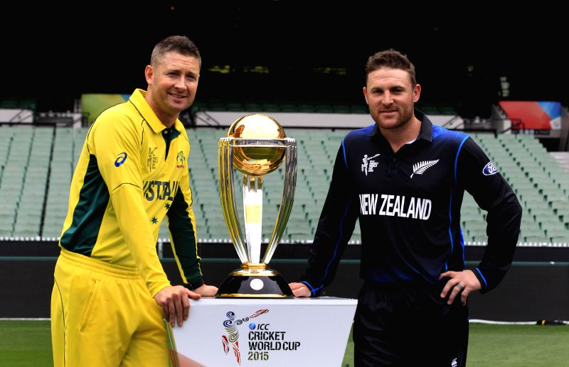 New Zealand ODI team captain Brendon McCullum and Australian ODI team captain Michael Clarke during a photo shoot with the Cricket World Cup trophy at the Melbourne Cricket Ground in ... - Brendon M