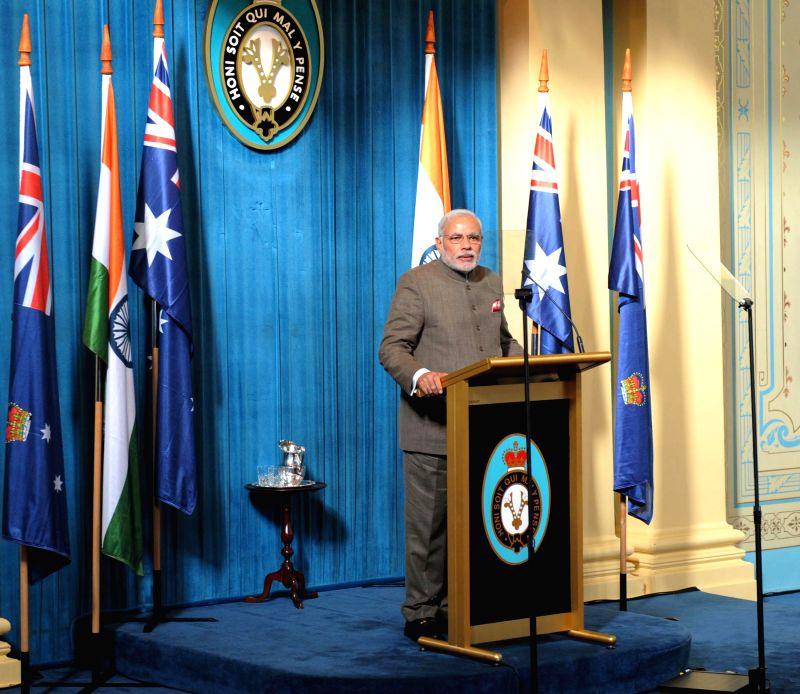 Prime Minister Narendra Modi addresses business leaders, in Melbourne, Australia on Nov 18, 2014. - Narendra Modi