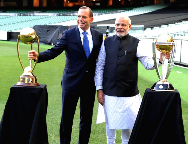 Prime Minister Narendra Modi with Prime Minister of Australia Tony Abbott during a Civic Reception hosted by the Abbott , at MCG in Melbourne, Australia, on Nov 18, 2014. - Narendra Modi
