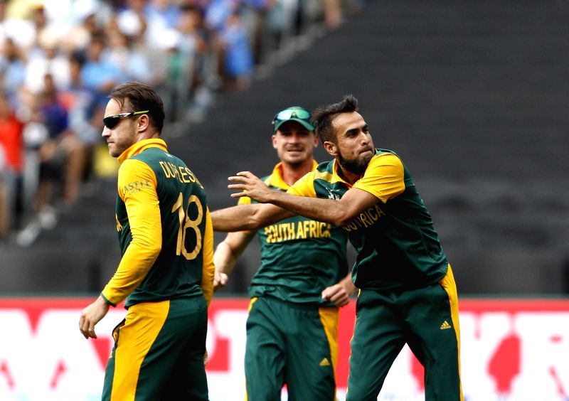 South African cricketers celebrate fall of a wicket during an ICC World Cup 2015 match between India and South Africa at Melbourne Cricket Ground, Australia on Feb 22, 2015.