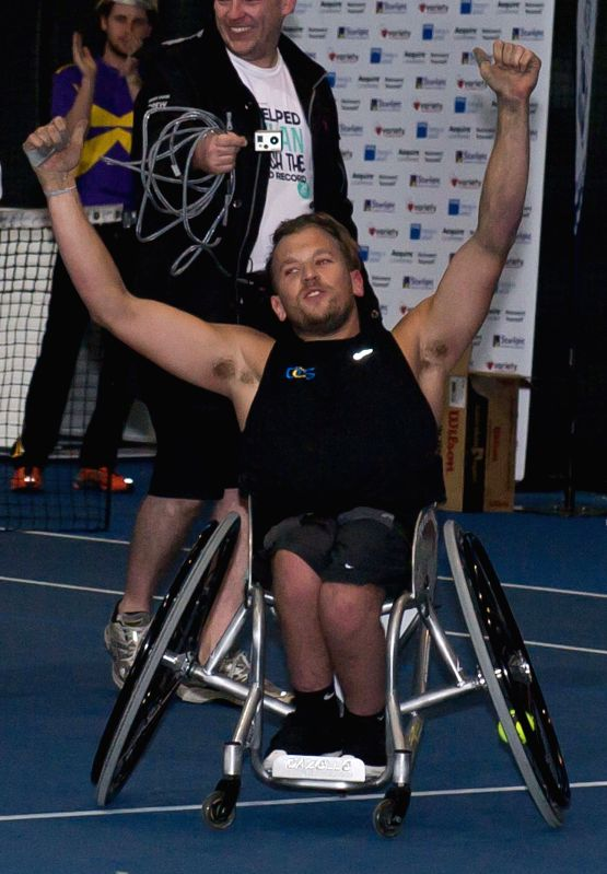 World number two wheelchair tennis star Dylan Alcott celebrates after his 24-hour wheelchair tennis marathon to raise money for charity in Melbourne, Australia, Dec. 12, 2014. (Xinhua/Bai .