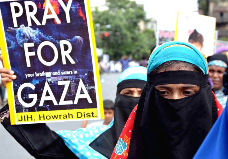 Member of Jammat-e-Islami Hind take part in a protest rally against Israeli attacks on Gaza in Kolkata on Aug. 30, 2014.