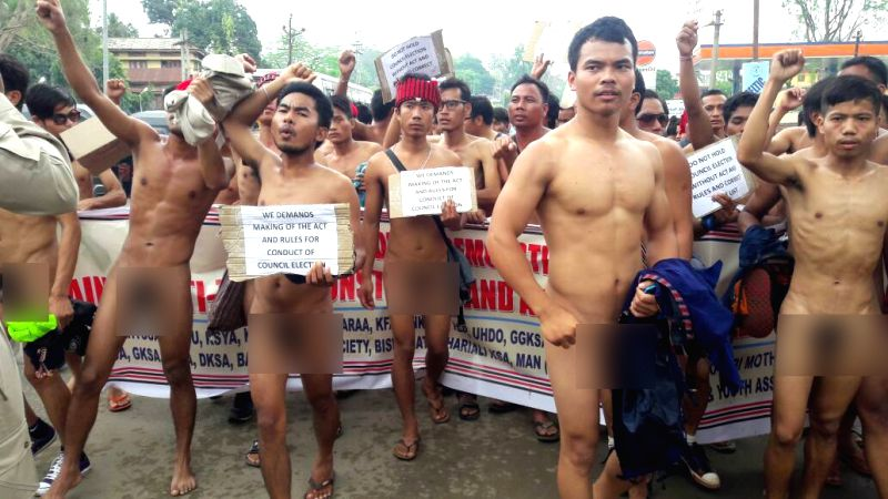 Members of 24 tribal unions stage a 'nude' protest demanding that only Tribals should be allowed to vote in the upcoming elections at Diphu in Karbi Anglong district of Assam on April 21, ...