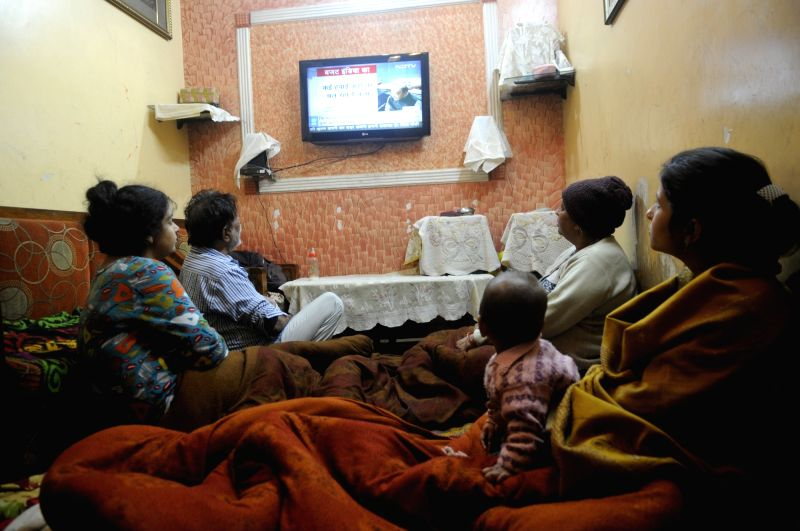 Members of a family watch the broadcast of the Budget 2018-19 in New Delhi on Feb 1, 2018.