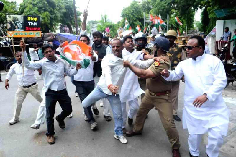Members of a minority group clash with police during a demonstration in Lucknow on July 25, 2014.