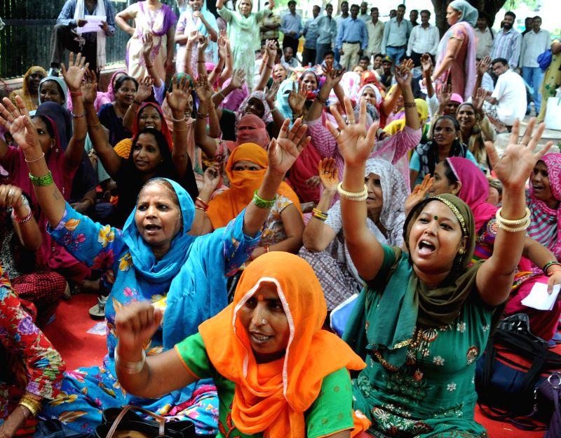 Members of Akhil Bhartiya Safai Majdoor Congress stage a demonstration at Jantar Mantar in New Delhi on July 28, 2014.