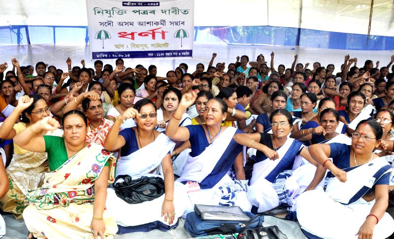 Members of All Assam Asha Workers Union stage a demonstration to press for their demands in Guwahati on Aug 28, 2014.