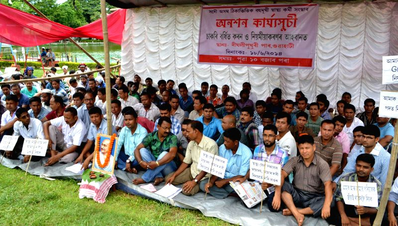 Members of All Assam Contractual M.P.W (M) Employees Union go for a hunger strike to press for their various demands at Prasanti Udayan in Guwahati on June 18, 2014.