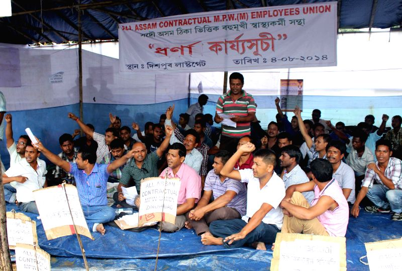 Members of All Assam Contractual Multipurpose Workers (Male) Employees' Union stage a demonstration to press for their demands in Guwahati on Aug 5, 2014.