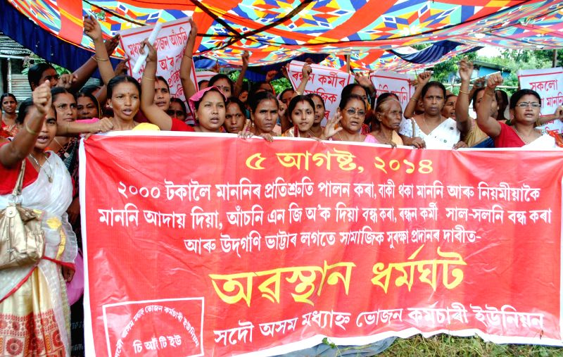 Members of All Assam Mid-day Meal Workers' Union stage a demonstration to press for their demands in Guwahati on Aug 5, 2014.