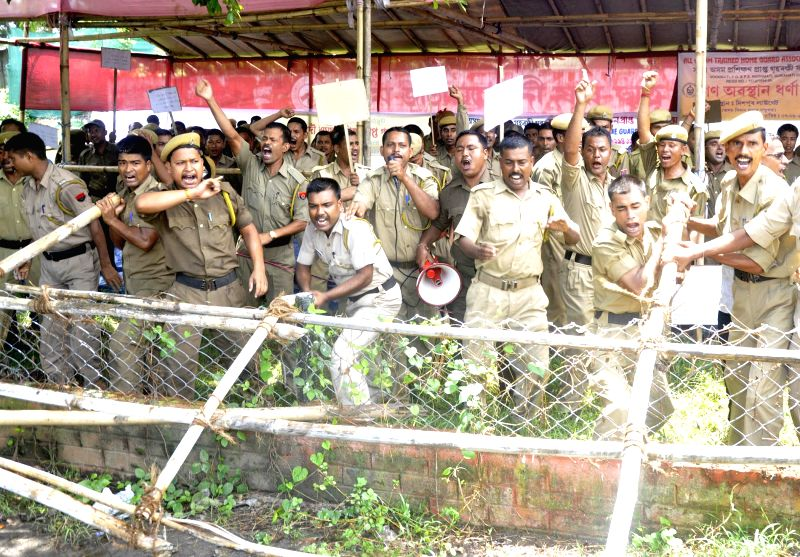 Members of All Assam Trained Home Guard Association (AATHGA) break barricades as they demonstrate to press for their demands in Guwahati on Aug 7, 2014.