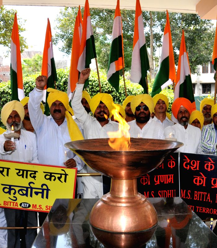 Members of All-India Anti-Terrorist Front (AIATF) paying tribute to the martyrs on the eve of 95th anniversary of Jallianwala Bagh massacre at Jallianwala Bagh in Amritsar on April 12, 2014.
