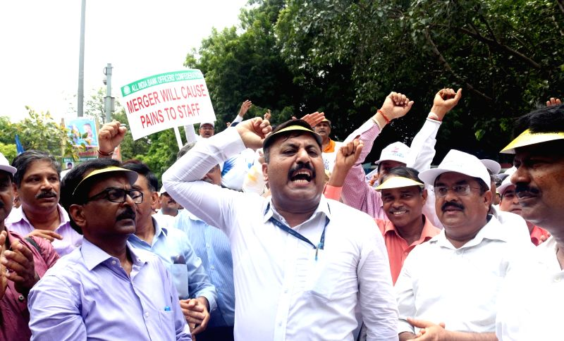 Members of All India Bank Officer's Confederation (AIBOC) stage a protest rally against central government in New Delhi, on Aug 9, 2016.