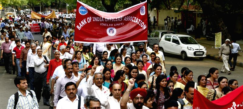 Members of All India Bank Officers' Confederation take out a rally to press for declaration of International Workers' Day as a public holiday at Jantar Mantar in New Delhi on May 1, 2014.
