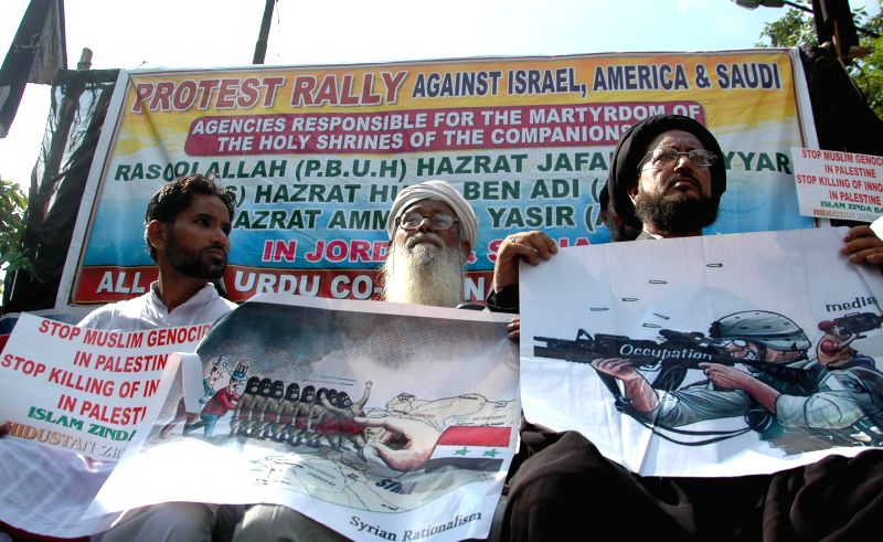 Members of All India Urdu Co-Ordination Committee participate in a rally to protest against Israel, America and Saudi Arabia in Kolkata on July 25, 2014.