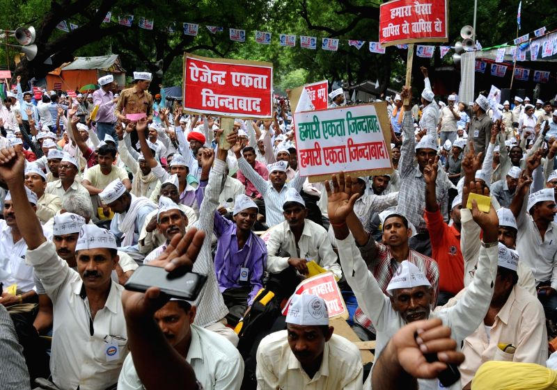 Members of All Investor Safety Organisation stage a demonstration to press for their demands at Jantar Mantar in New Delhi on July 31, 2016.