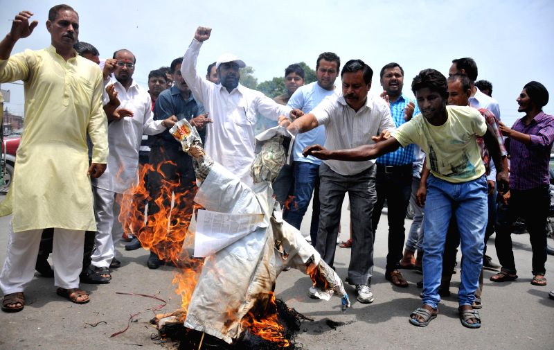 Members of Amaranth Sewa Mandala demonstrate against Jammu and Kashmir Chief Minister Omar Abdullah in Amritsar on July 18, 2014. - Omar Abdullah