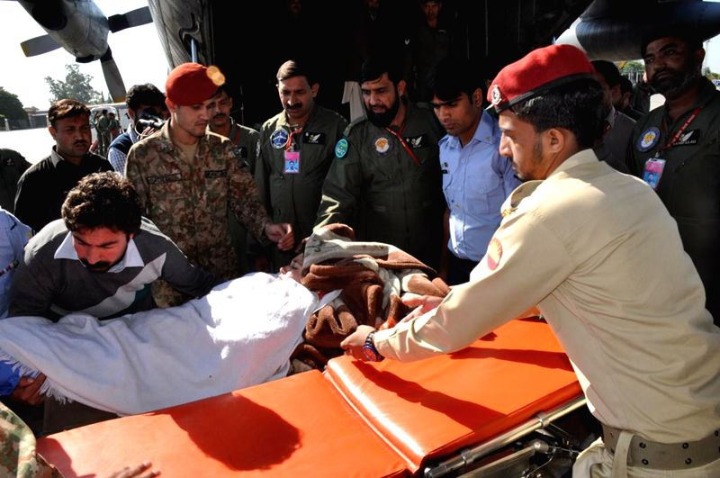 Members of an army medical team transfer an injured earthquake victim at a military base in Rawalpindi, Pakistan, Oct. 27, 2015. Pakistani government, army and ...