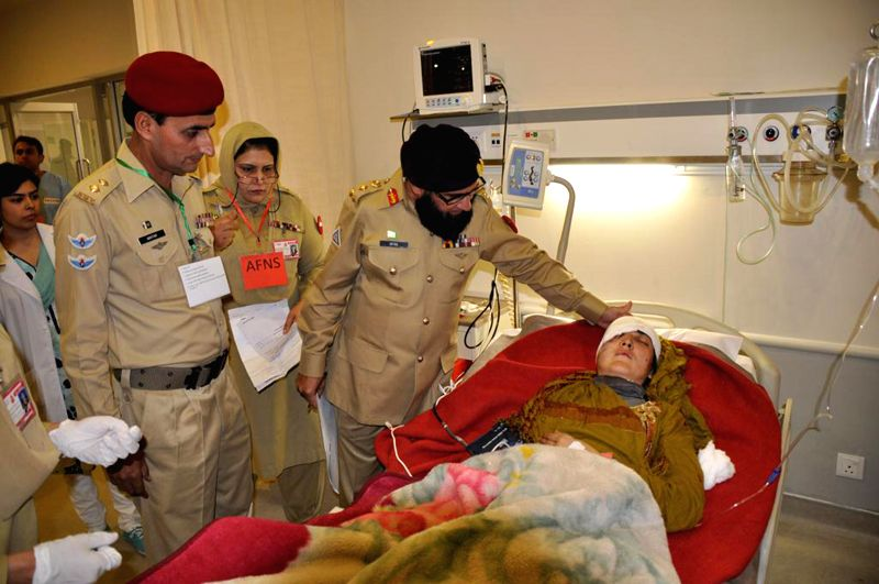 Members of an army medical team treat an injured earthquake victim at a military hospital in Rawalpindi, Pakistan, Oct. 27, 2015. Pakistani government, army and ...
