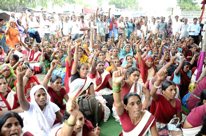 Members of Anganwadi cooks Sangh demonstrate to press for their various demands in Patna on July 24, 2014.