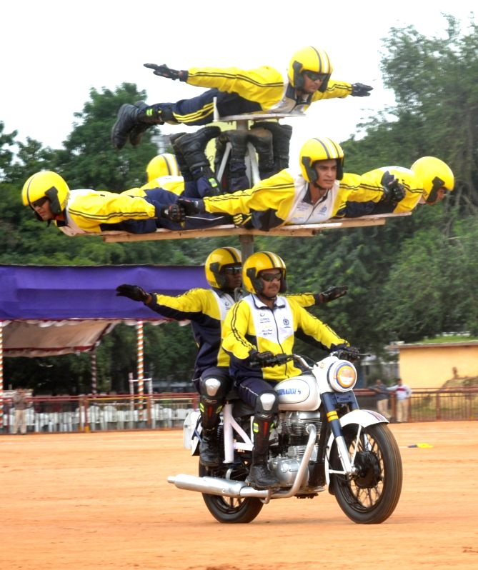 "Members of ASC Motorcycle team ""Tornadoes"" perform during the rehearsal for the Independence Day parade at Manekshaw Parade grounds, in Bengaluru on Aug 11, 2018."
