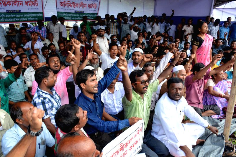 Members of Asom Sikshak Karmachari Akyo Mancha (ASKAM) stage a demonstration to press for their demands in Guwahati on Aug 4, 2014.