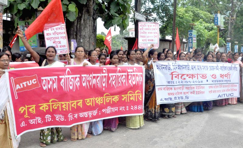 Members of Asom State Anganwadi Helpers Union (ASAHU) stage a demonstration to press for their various demands in Guwahati on July 22, 2014.