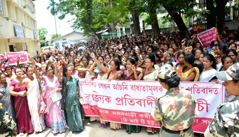 Members of Assam State Anganwadi Workers and Helpers Union under the banner of CITU staging protest outside the office of Directorate of Social Welfare, Assam in support of their various demands in ..