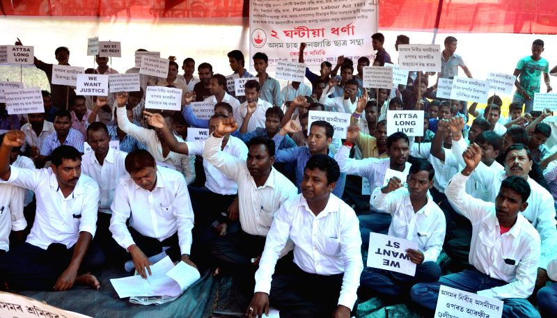 Members of Assam Tea Tribal Students Association (ATTSA) stage a demonstration in Guwahati on Aug 28, 2014.