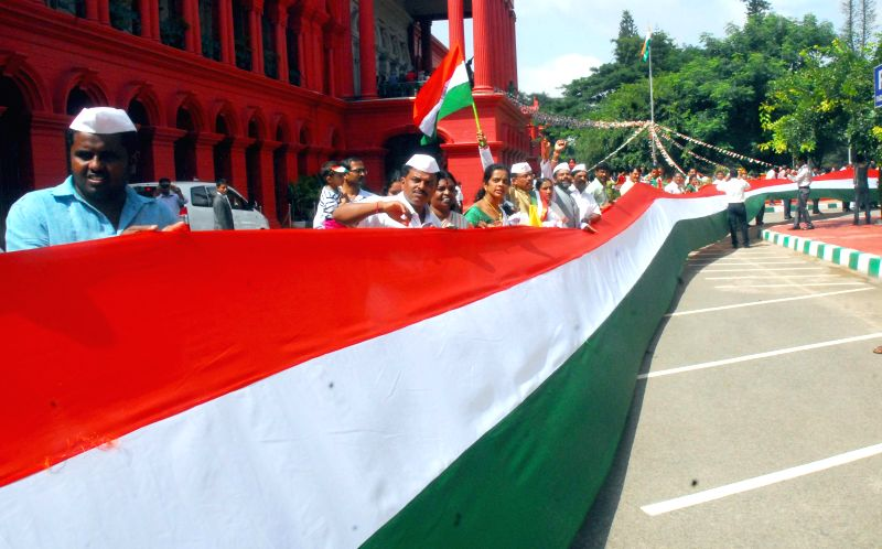Members of Bangalore Advocates Association celebrate Independence day with a long national flag, which they claim to be the longest flag, in Bangalore on Aug 15, 2014.
