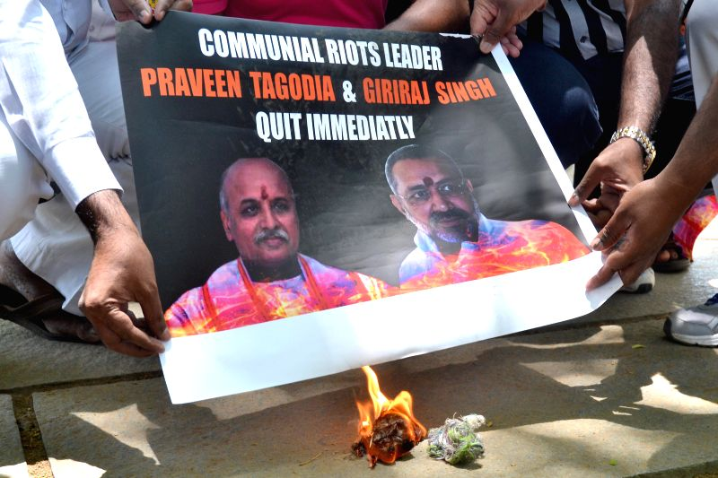 Members of Bangalore City Youth Congress demonstrate against VHP chief Pravin Togadia and BJP leader Giriraj Singh in Bangalore on April 22, 2014.