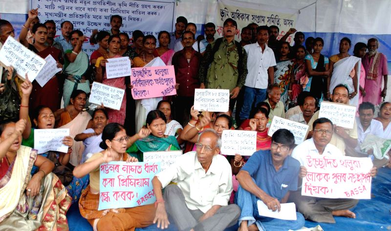 Members of Bhumi Adhikar Sangram Samiti (BASS) stage a demonstration to press for their demands in Guwahati on Aug 5, 2014.
