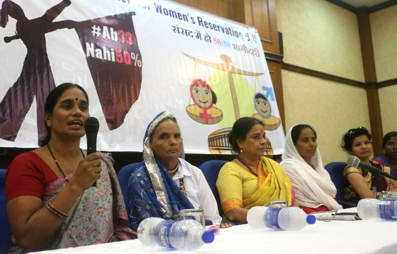 Members of Centre for Social Research and the National Alliance for Women's Reservation Bill during a press conference organised to launch 'National Women's Charter' and demand 'Tabling of ...