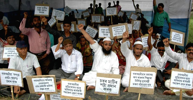 Members of Char-Chapori Sahitya Parishad stage a demonstration to press for their demands in Guwahati on Aug 13, 2014.