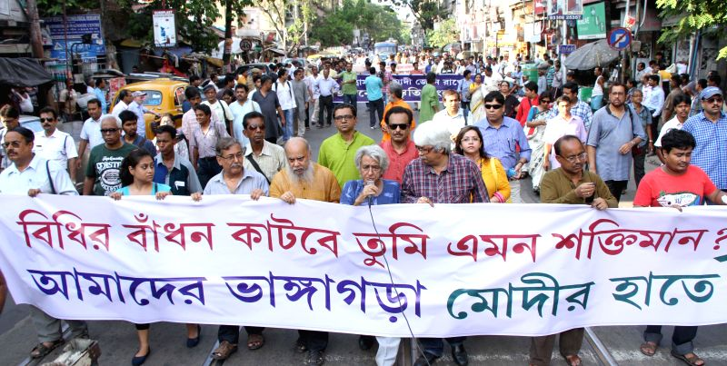 Members of civil society take part in a protest rally against BJP Prime Ministerial candidate and Gujarat Chief Minister Narendra Modi in Kolkata on May 6, 2014.