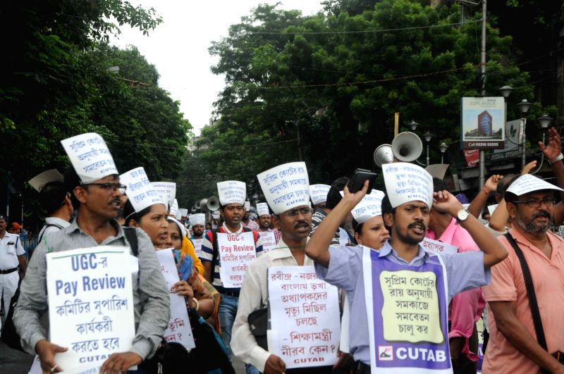 Members of College and University Teachers' Association of Bengal (CUTAB) stage a demonstration to press for their various demands, in Kolkata on July 17, 2018.