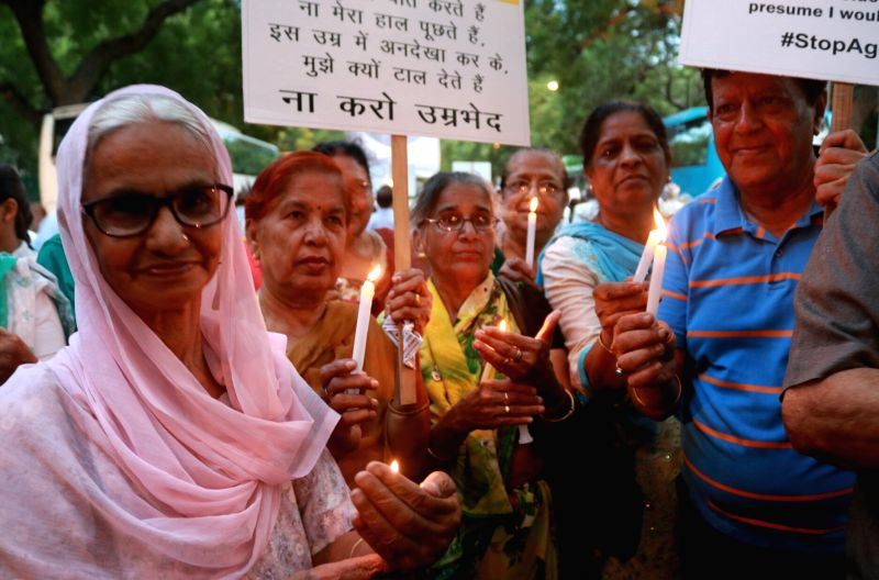 Members of Delhi Senior Citizen association take out a candle light march on the eve of World Elder Abuse Awareness Day 2017 at Jantar Mantar in New Delhi on June 14, 2017.