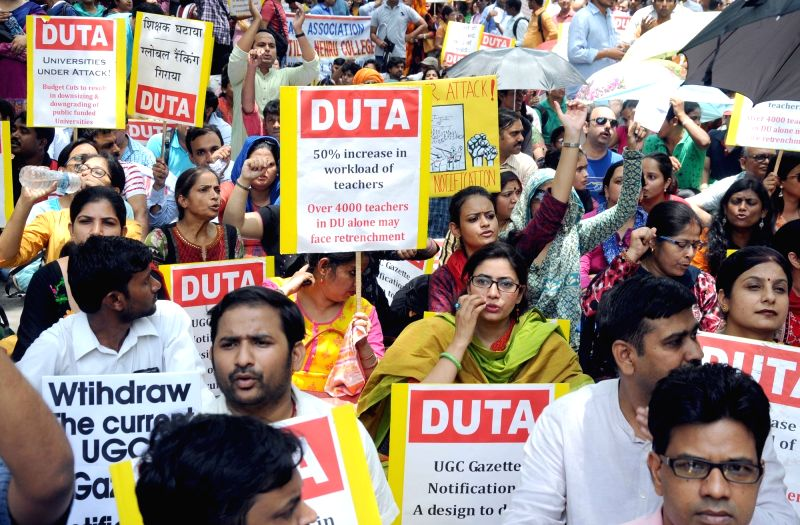 Members of Delhi University Teachers Association (DUTA) stage a demonstration to press for their demands including withdrawal of Academic Performance Indicators (API) system in New Delhi, ...