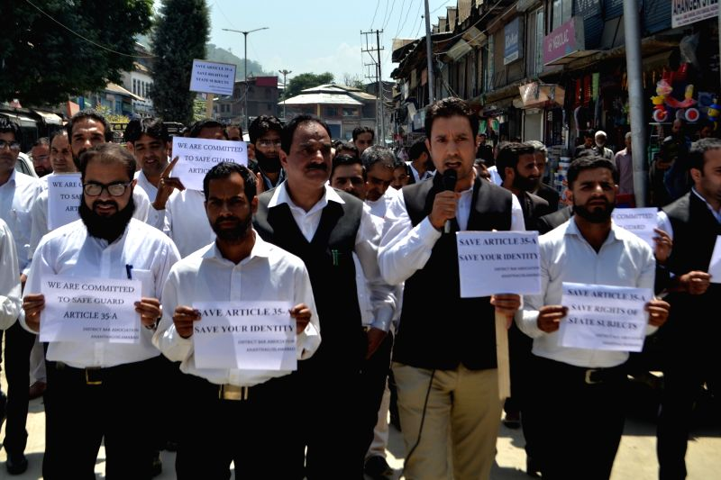 Members of District Bar Association Anantnag stage a demonstration to show support for the protection of the Constitutions's Article 35A which has been challenged in the Supreme Court, in ...