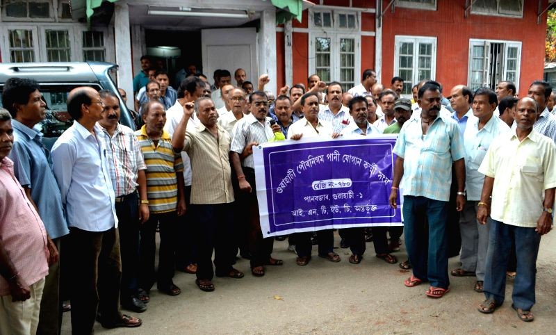 Members of Guwahati Municipal Corporation Water Supply Workers Association stage a demonstration to press for their demands in Guwahati on Sept 4, 2014.